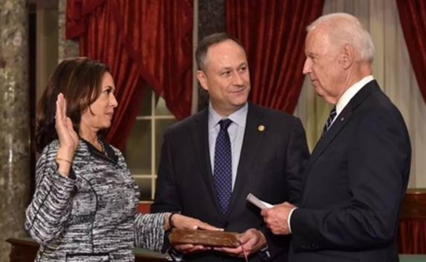 Vice President Joe Biden swears in Sen. Kamala Harris, D-California, while her husband Doug Emhoff holds a long-kept family Bible, Jan. 3, 2021.