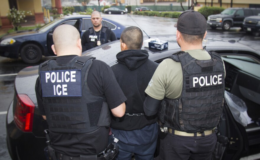 U.S. Immigration and Customs Enforcement make an arrest in Los Angeles, Feb. 7, 2017.