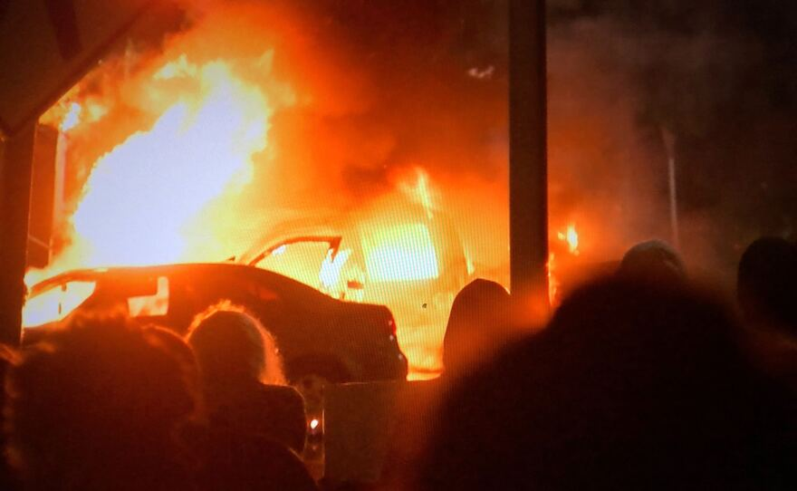 A vehicle engulfed in flames in front of La Mesa City Hall on May 30, 2020, as the protest over police brutality escalated to chaos and vandalism.