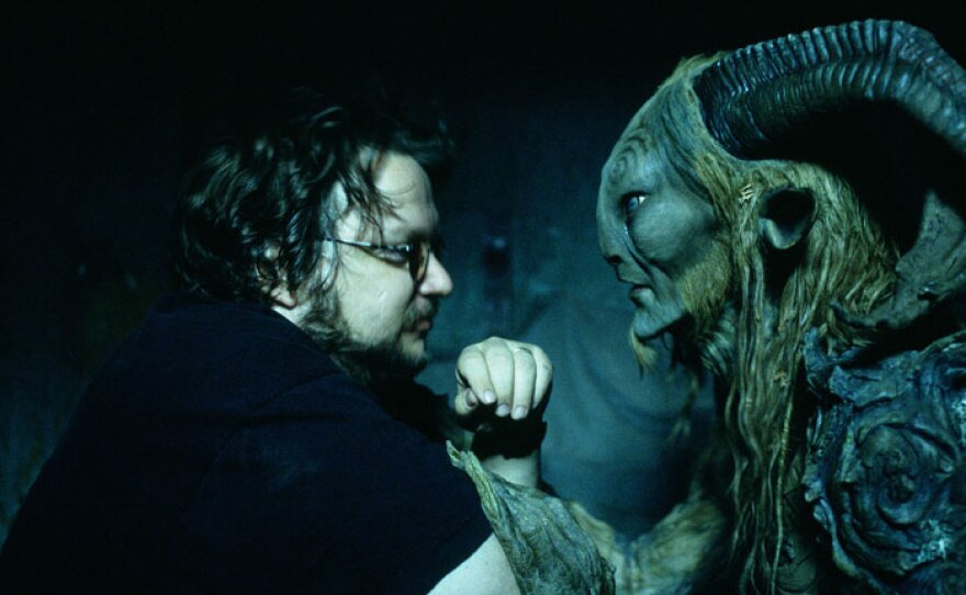 """Director Guillermo del Toro with actor Doug Jones on the set of """"Pan's Labyrinth"""" (2006)."""