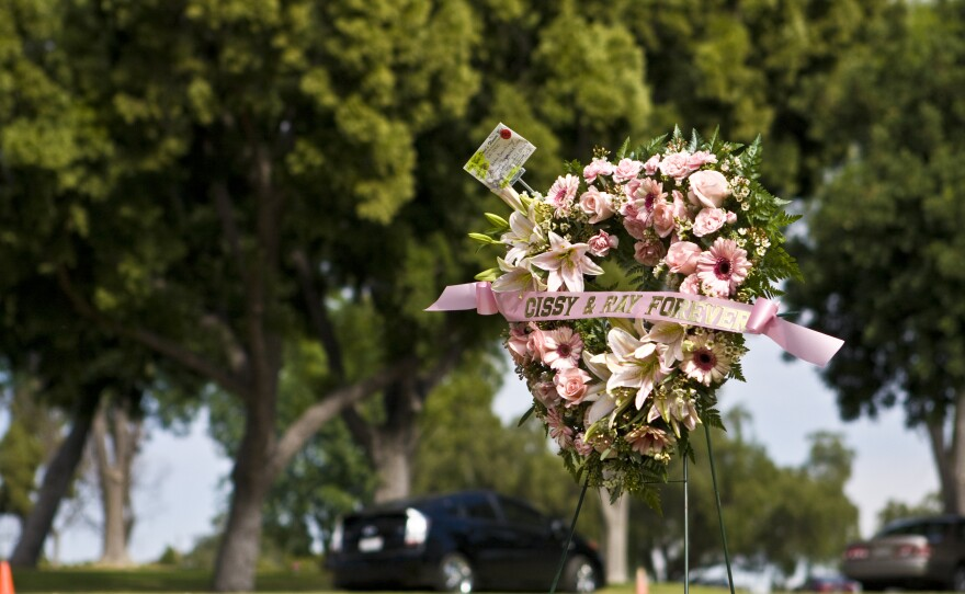 A wreath at the Valentine's Day ceremony reuniting detective novelist Raymond Chandler and his wife of 30 years, Cissy Chandler. The two were not buried together, despite their expressed wishes.