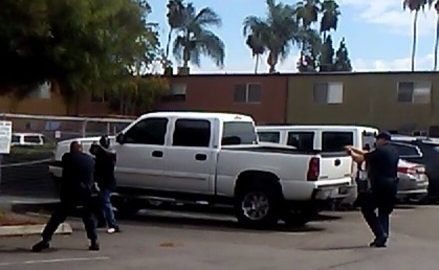El Cajon police officers confront Alfred Olango in the parking lot of a taco shop, Sept. 27, 2016.