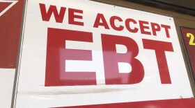 """An sign displaying """"We Accept EBT"""" is hung outside of a store in City Heights."""