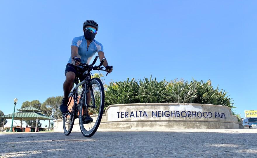 Oscar Tavera bikes through Teralta Park in City Heights, Sept. 23, 2020.