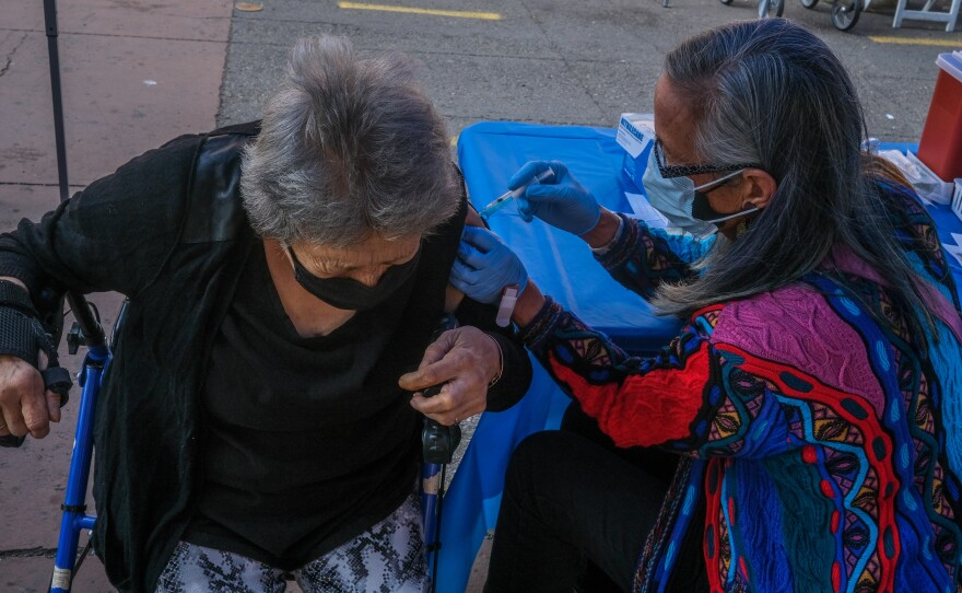 Anita Mendoza, 70, receives the first dose of her vaccine outside of Father Joe's downtown on February 11th, 2021.