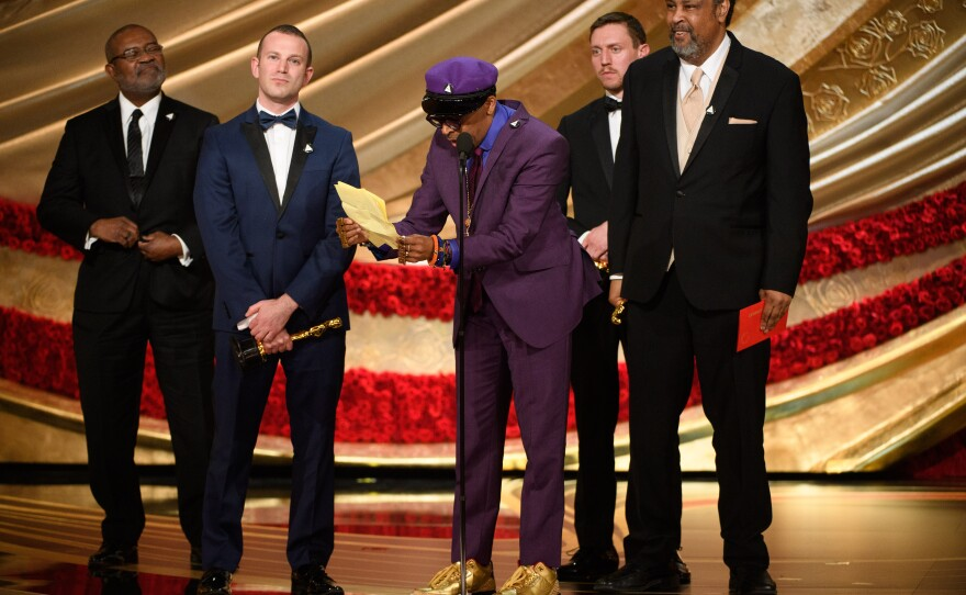 """A very thrilled and excited Spike Lee picks up an Oscar for Best Adapted Screenplay for """"BlackKklansman."""" Feb. 24, 2019"""