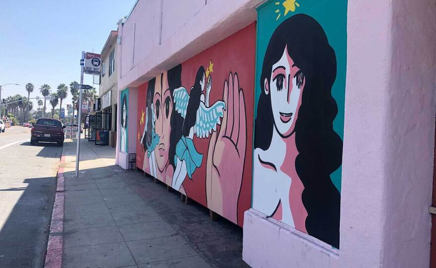 A mural by artist Fifí Martínez is situated at a busy bus stop along San Ysidro Blvd, pictured on September 25, 2020.