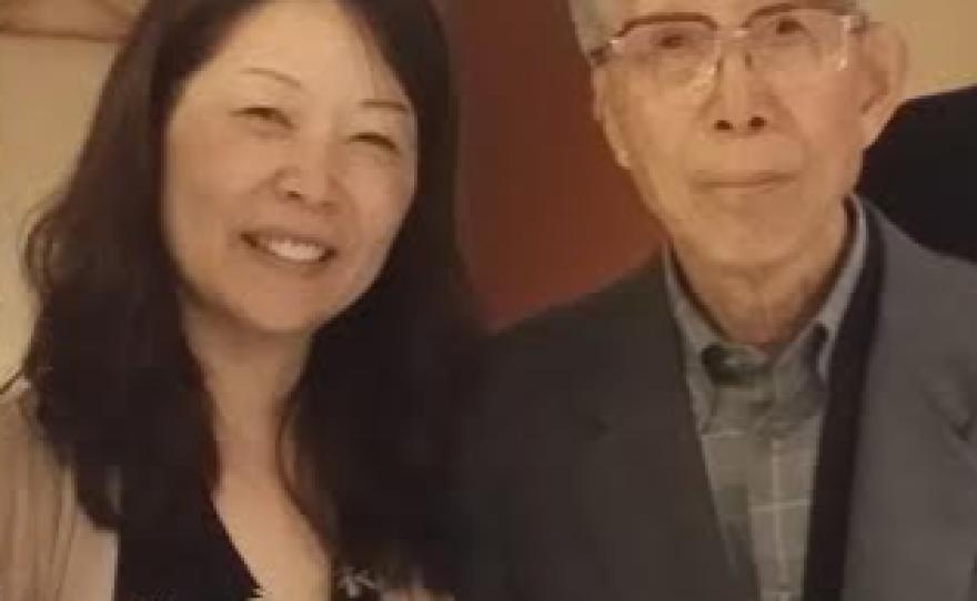 Akiko Mikamo stands with her father, Shinji Mikamo, in this undated photo.