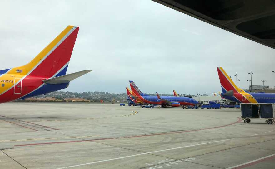 Southwest Airlines planes sit at the gate at San Diego International Airport on June 3, 2021.