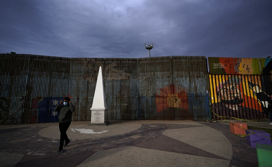 A man passes at Friendship Park, near where the border separating Tijuana, Mexico, and San Diego meets the Pacific Ocean, Jan. 19, 2021, in Tijuana, Mexico.