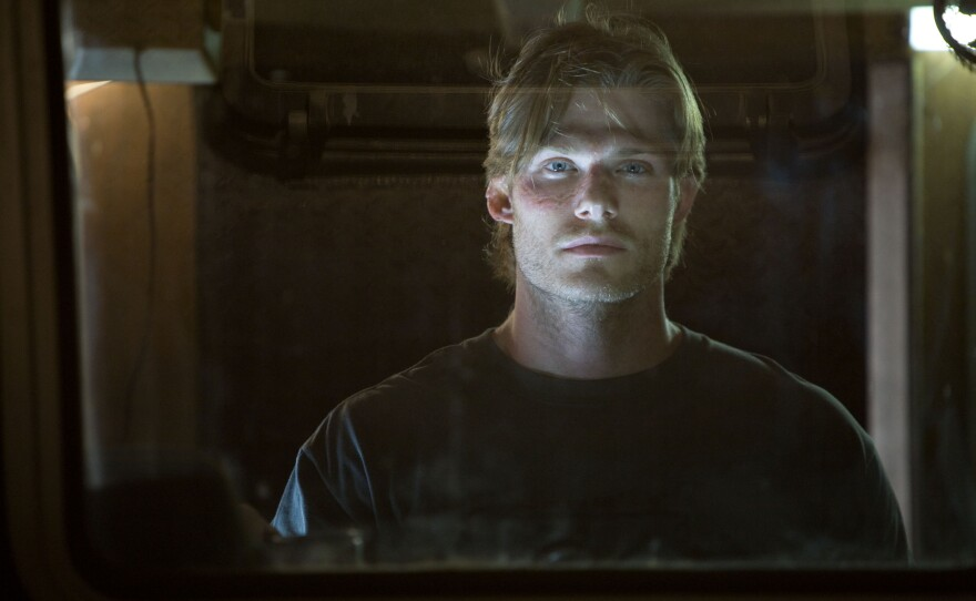 """Chris Carmack is the one pretty boy among rednecks in """"Shark Night 3D."""" He also looks like a young Viggo Mortensen. In fact there are also young looking versions of Reese Witherspoon, Tom Green, and Chris Evans in the cast."""