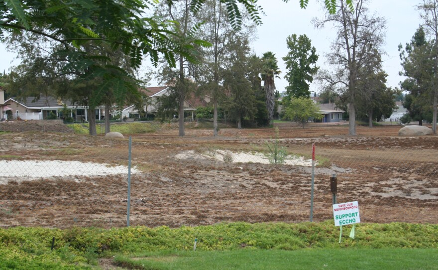 The former Escondido Country Club golf course has turned brown since its developer stopped watering it, Aug. 20, 2014.