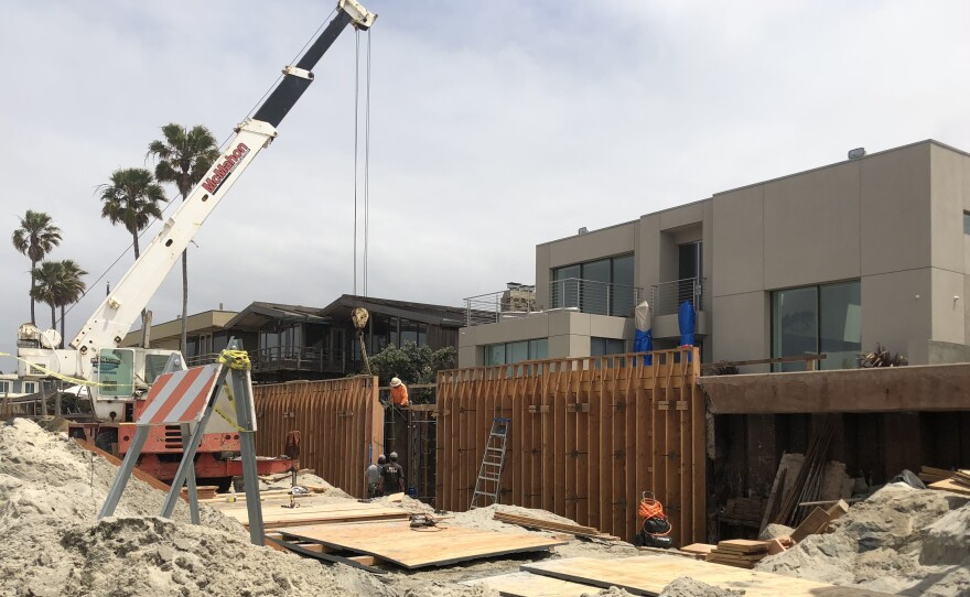 A seawall is constructed along the beach in Del Mar to protect homes from rising ocean levels, May 21, 2018.