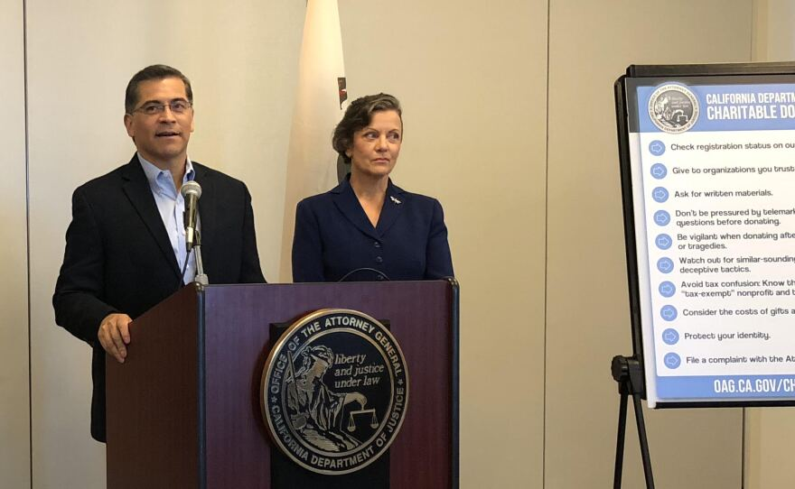 California Attorney General Xavier Becerra and Tania Ibanez, special assistant attorney general, in San Diego, Nov. 13, 2018.