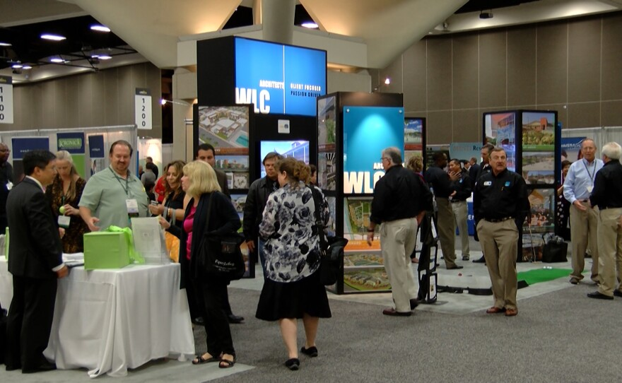 Educators at the California School Board Association's annual conference explore the San Diego Convention Center's halls looking at trade show booths, Dec. 4, 2015.