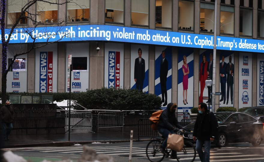 News headlines on the impeachment trial of Donald Trump are displayed outside of the Fox headquarters in February in New York City.