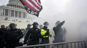 Police hold off Trump supporters who tried to break through a police barrier, Wednesday, Jan. 6, 2021, at the Capitol in Washington.
