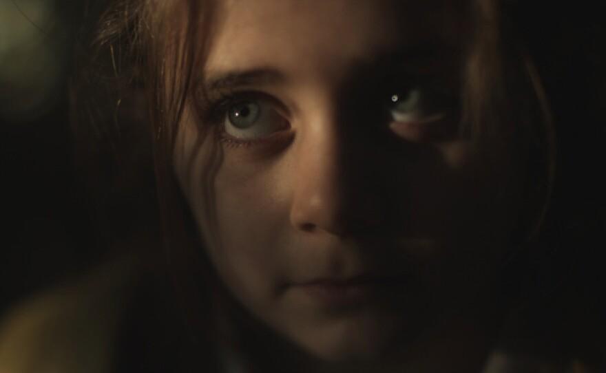 "The observing eyes of Rachel Resheff in ""3 Backyards."""