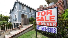 """A """"For Sale by Owner"""" sign is posted in front of property in Monterey Park, Calif., in April 2020."""
