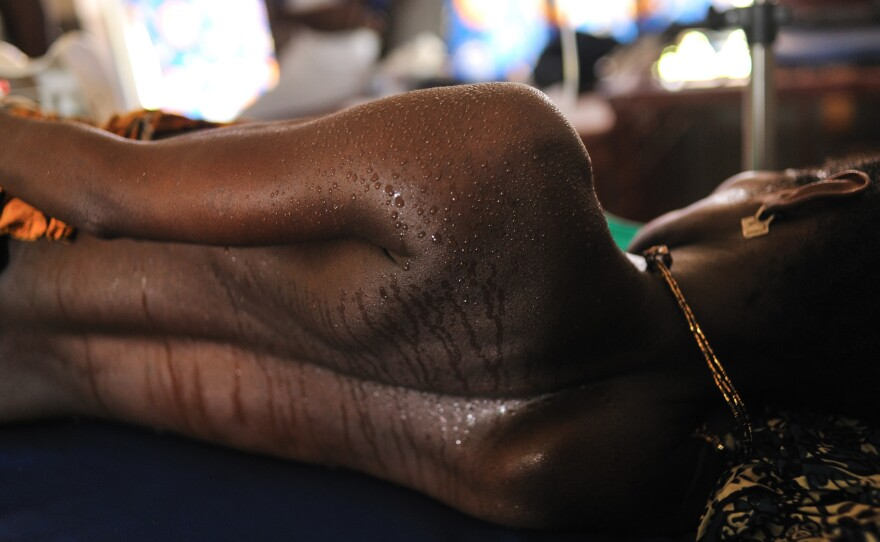 A woman in labor in the maternity ward at the Princess Christian Maternity Hospital in Freetown, Sierra Leone. With lockdowns have come fears of even greater numbers of home births.