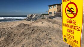 Pollution warning sign posted in Imperial Beach near the southern end of Seacoast Drive on Jan. 31, 2020.
