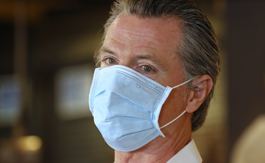 California Gov. Gavin Newsom is seen here in Sacramento on Friday. The number of people hospitalized with COVID-19 in the state have been rising in recent days.