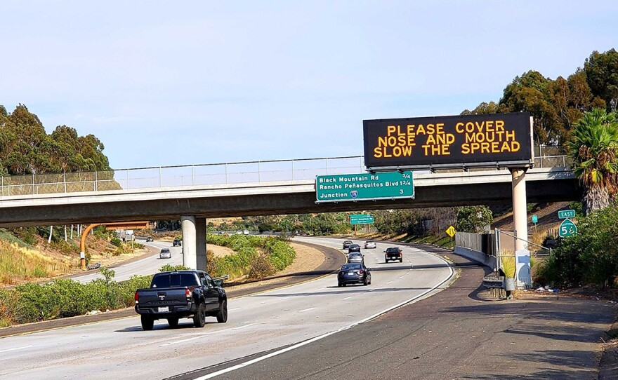 An electronic sign on state Route 56 in Rancho Peñasquitos on Aug. 16, 2020, advising residents the correct way to wear a mask to stem the spread of the coronavirus in California.