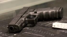A pistol lies on the counter at San Diego Guns, June 16, 2020.