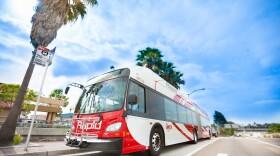 A San Diego Metropolitan Rapid bus is shown.