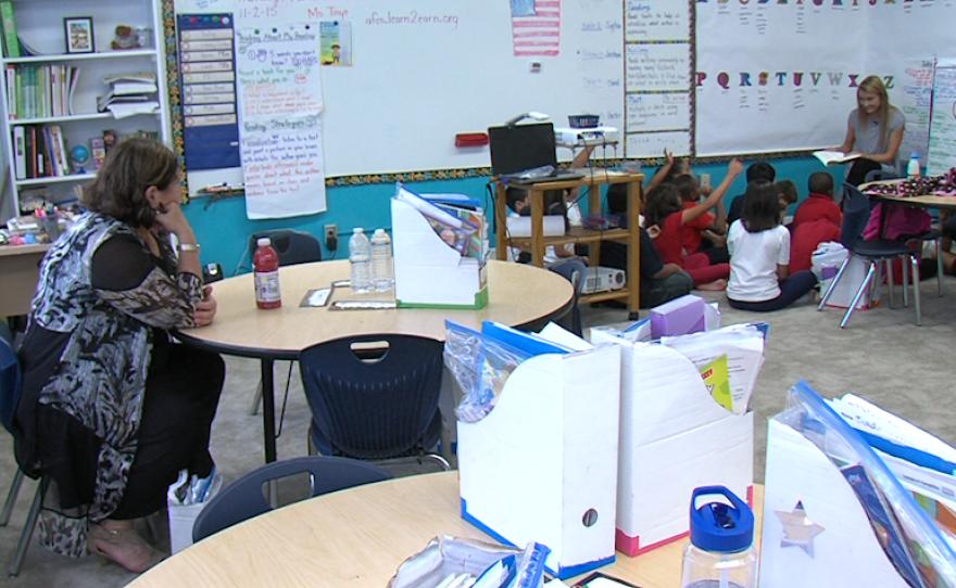 America's Finest Charter School Director Jan Perry observes Cassandra Tinyo's class, Nov. 2, 2015.