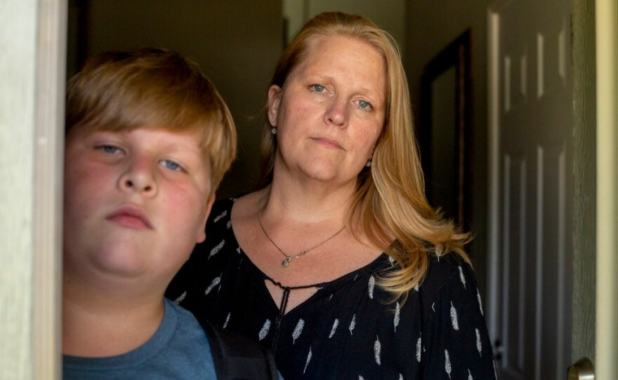Kayden Christiansen and his mother, Heather Christiansen, at their home in Simi Valley, August 2021. Kayden, a fifth-grader, was in quarantine for 10 days shortly after his California school reopening.
