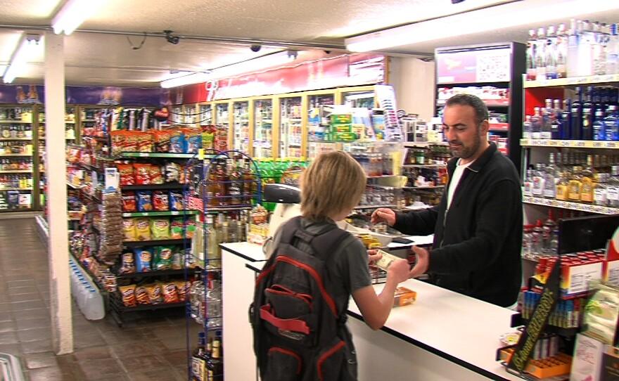 Mathaey Nisso, the owner of Oak Shores Malt Shop near Lake Morena, rings up a customer.