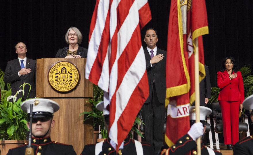San Diego City Council President Todd Gloria and Councilwoman Sherri Lightner lead the audience in a pledge of allegiance during the City Council inauguration ceremonies, Dec. 10, 2014.