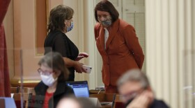 Senate Republican Leader Shannon Grove, left, of Bakersfield, and Senate President Pro Tem Toni Atkins, of San Diego, talk in the back of the Senate Chamber as senators debated the state budget at the Capitol in Sacramento, Calif., Thursday, June 25, 2020.