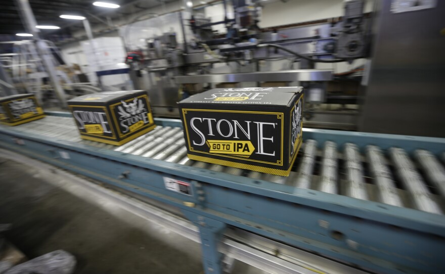 Workers brew, bottle and pack craft beer at Stone Brewery in Escondido, Oct. 13, 2015.