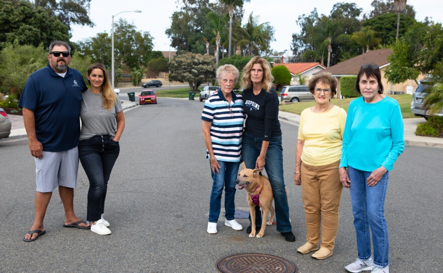 A group of Encinitas residents who have clashed with a neighboring hemp farm are shown on July 13, 2021.