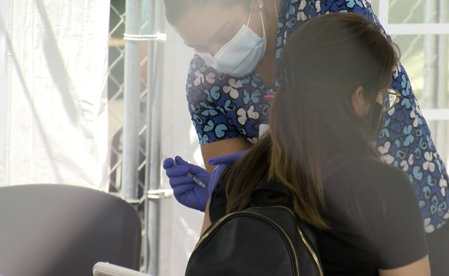 Janet Jurado receives a COVID-19 vaccine at the Family Health Center in Logan Heights on August 26, 2021.