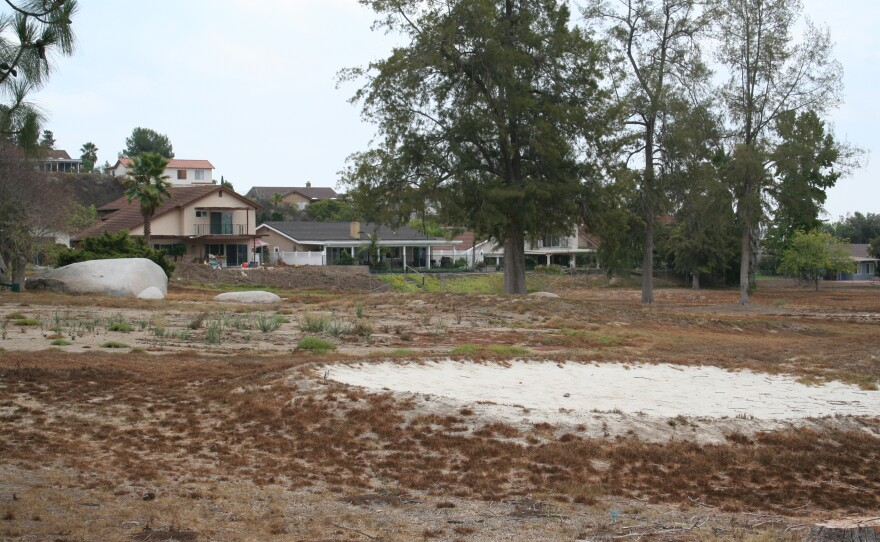 Homes butt up against one of the former fairways of the Escondido Country Club, Aug. 20, 2014.