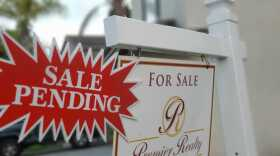 """A """"for sale"""" sign is pictured in front of a house in Chula Vista in this file photo from July 21, 2020."""