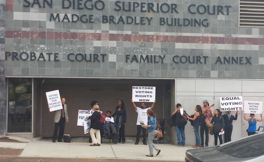 Disability rights advocates from Spectrum Group protest outside the San Diego Superior Court building on August 23, 2016. The group wants California judges to notify people with disabilities who have been disqualified from voting that they can regain their rights under a new law.