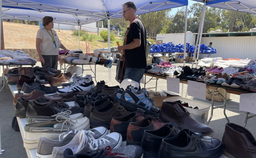Tables full of shoes, blankets, and tote bags at the North County Veterans Stand Down event in Vista. September 16, 2021.