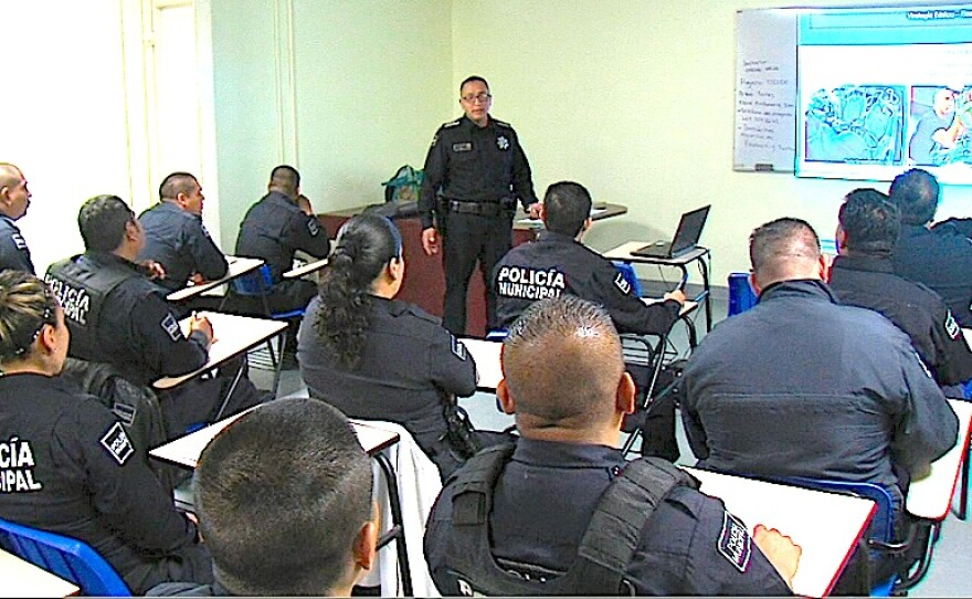 Tijuana police sub inspector Cesar Quinones talks to a roomful of officers at the police academy, April 25, 2015.
