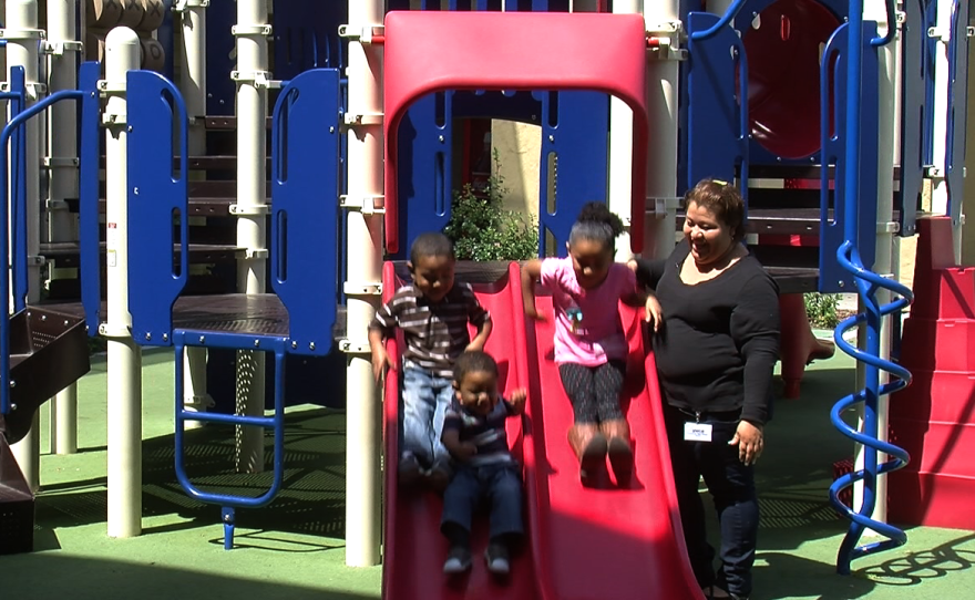 Rocio Turner's children enjoy playing on the playground at the YWCA Cortez Hill Family Center.