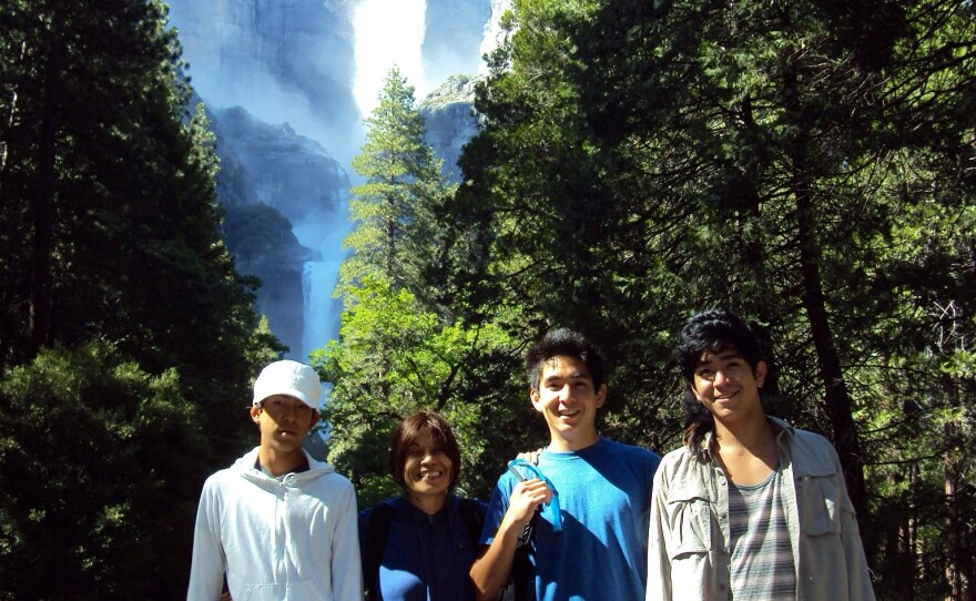 Kcomt, 2nd from left, on vacation with her three sons.