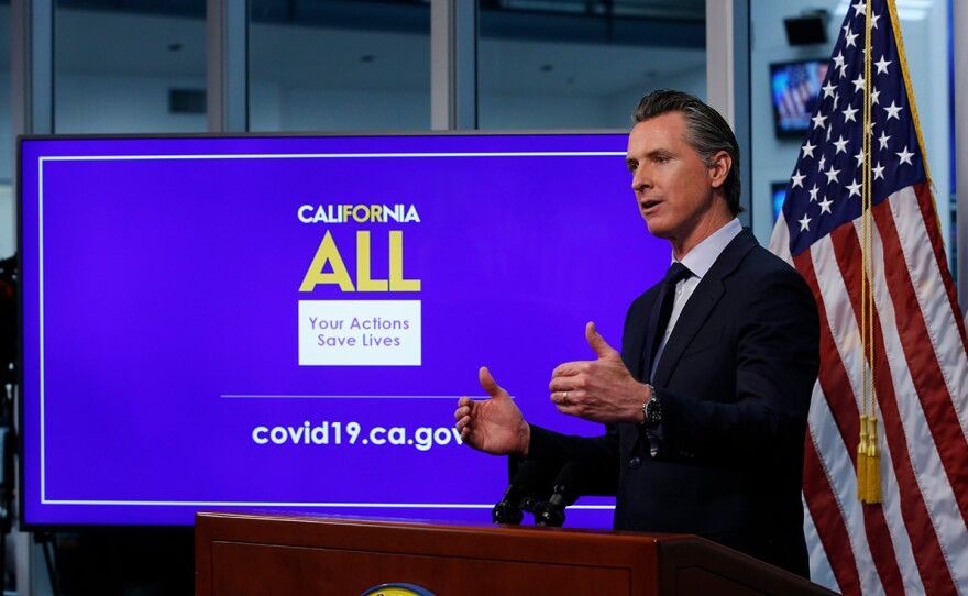 n this photo taken Tuesday, April 14, 2020, Gov. Gavin Newsom discusses an outline for what it will take to lift coronavirus restrictions during a news conference at the Governor's Office of Emergency Services in Rancho Cordova, Calif.