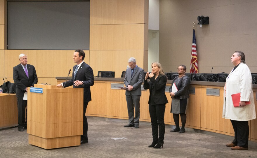 San Diego County Supervisor Nathan Fletcher speaks at a news conference on the coronavirus pandemic. To his right is then-Board of Supervisors Chairman Greg Cox, March 19, 2020.