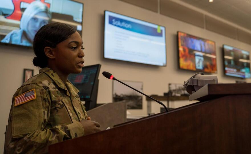 """Staff Sgt. Shameka Dudley, a Fort Bragg linguist, pitched her idea at the 18th Airborne Corps """"Dragons Lair"""" event. She proposed using virtual reality to get soldiers to be proactive when they see sexual harassment or abuse."""