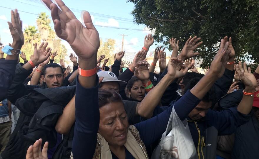 Central Americans participate in street mass in Tijuana, Nov. 23, 2018.