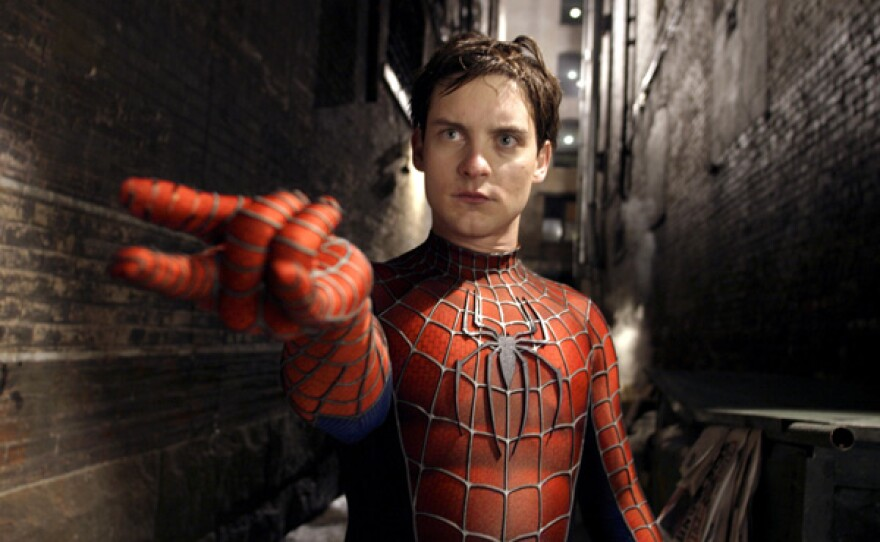 """Tobey Maguire spinning a web as Spidey in """"Spider-Man 2."""""""