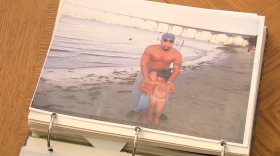 Anastasio Hernandez Rojas stands with two of his children at a Coronado beach in this undated photograph.